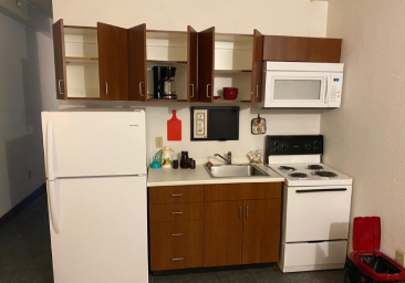 Extended stay property with fully-equipped kitchen, living room, and bedroom.